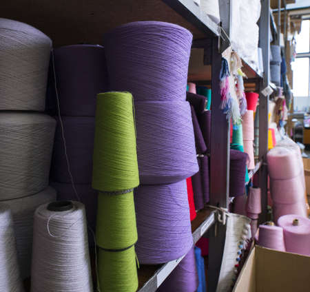 Spools with color thread at knitting shop view 版權商用圖片