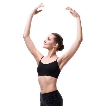 Slim girl in black sportswear dancing shot 版權商用圖片