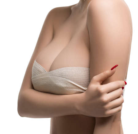 Girl her head and neck bandaged at plastic surgeon Stockfoto