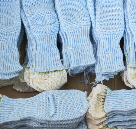 Knitted socks workpieces at knitting shop Stockfoto