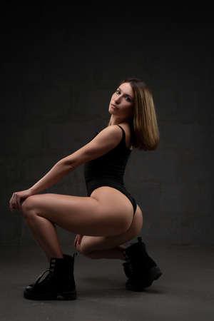 sexy blonde woman in black bodysuit