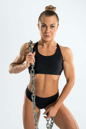 Athletic woman with chain on body