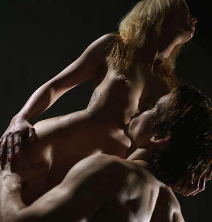 Young passionate couple having sex studio shot