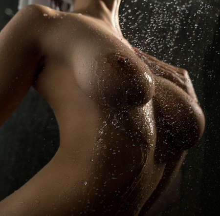 Sexy model posing naked in shower