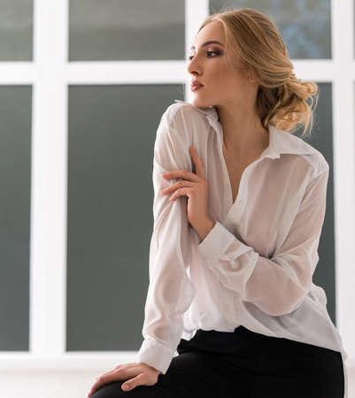 Pretty woman in sexy white shirt studio portrait Stockfoto