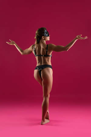Muscular woman in leather underwear and mask Stockfoto