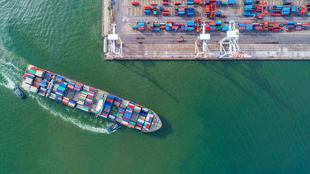 Aeriel view of a water transport shipping cargo to harbor.