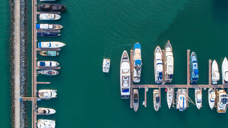 Pier speedboat. Aerial view of water transport at port harbour marina 版權商用圖片