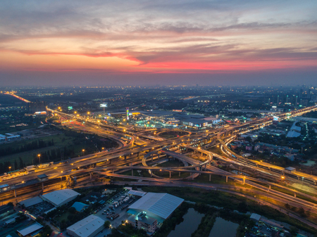 Aerial view, Road roundabout, Expressway with car lots in the city in Thailand.  beautiful Street , downtown, cityscape, Top view. Background Stock Photo