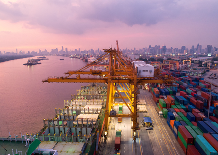 Aerial view of a trade port with container ship in import export and business logistic.