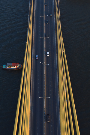 Aerial view Road, The expressway across the river has many cars in Thailand. Beautiful Street , Top view Background