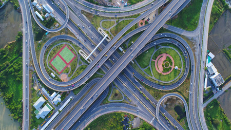 Aerial view Road roundabout, Expressway with car lots in the city in Thailand.beautiful Street , downtown,cityscape,Top view. Background,Aerial view city scape Reklamní fotografie