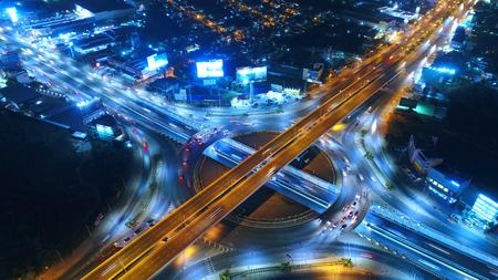 Aerial view Road roundabout, Expressway with car lots in the city in Thailand.beautiful Street , downtown,cityscape,Top view. Background,Aerial view city scape Stock Photo