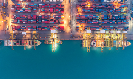 Container ship in export and import business and logistics. Shipping cargo to harbor by crane. Water transport International. Aerial view Stock fotó