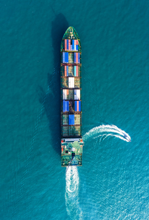 Container ship in export and import business and logistics. Shipping cargo to harbor by crane. Water transport International. Aerial view 版權商用圖片
