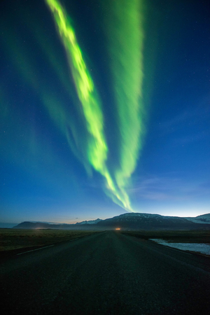 A wonderful night with Kp 5 . Northern lights mountain in Iceland.