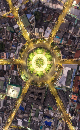 Aerial view Road roundabout, Expressway with car lots in the city in Thailand.beautiful Street , downtown,cityscape,Top view. Background,Aerial view city scape 版權商用圖片