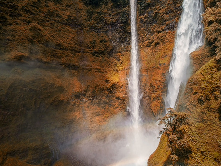 Beautiful waterfall.Tad Fan Waterfall in southern Laos.It is a place to visit the natural beauty.Mountain forest waterfall landscape.Top view,Aerial view,waterfall amazing nature background,Rainforest