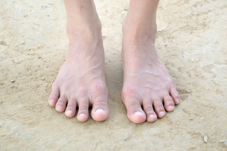 barefoot of woman stand on dry soil 스톡 콘텐츠