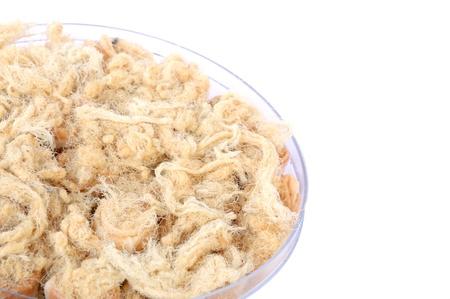 Dried shredded pork on white background  photo