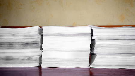 pile of papers on brown background photo