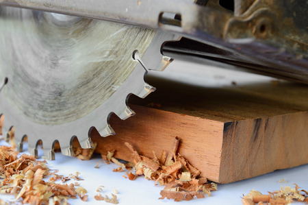 close up of circular saw and saw dust