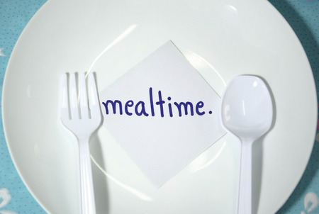 in twos: white empty plastic plate and cutlery with mealtime card (remind for mealtime)