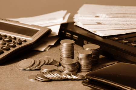 currency and receipts with laptop and calculator for financial concept  photo