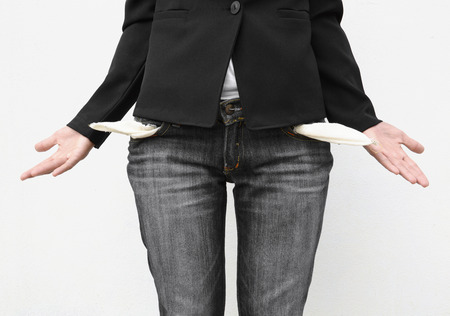 business woman showing her empty pocket isolated on white