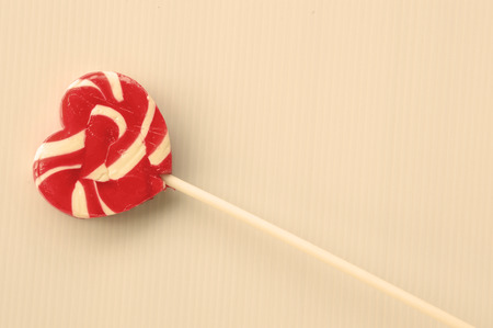 heart lollipop against the background photo