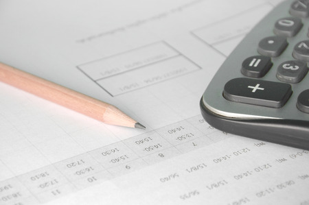 calculated: calculator on account book for financial