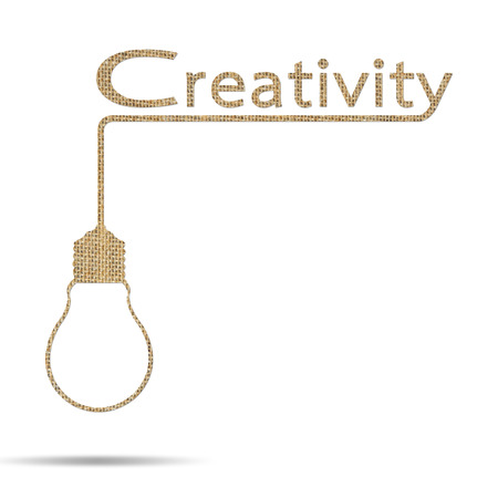 burlap creativity word with light bulb idea isolated on white photo