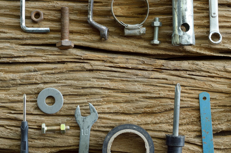 set of old tools on the wooden background photo