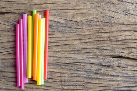 drinking straw: colorful plastic drinking straw on wooden background