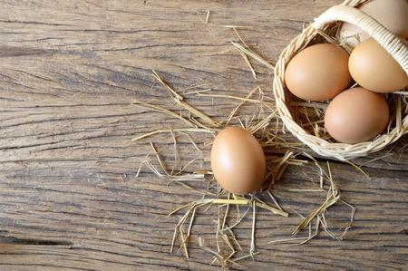 wicker basket: egg in wicker basket on wooden background