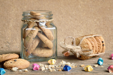 chocolate chip: chocolate chip cookie in glass bottle on wooden table Stock Photo
