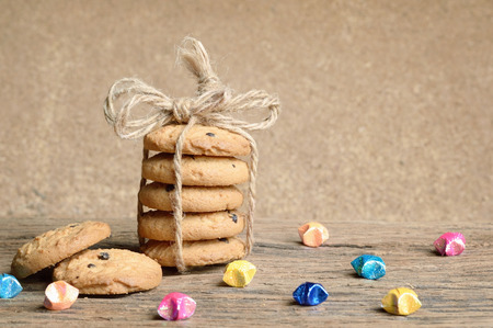 chocolate chip: pile of chocolate chip cookie on wooden table Stock Photo