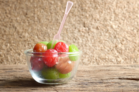 myrobalan: mix pickle cherry fruit in glass bowl on wooden table