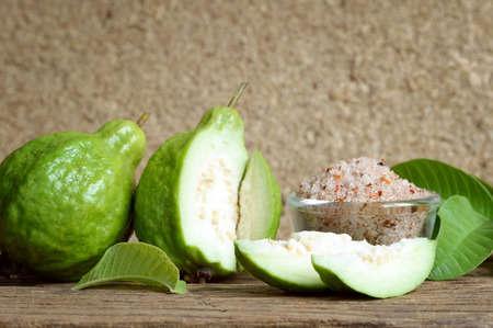 condiment: green guava with condiment on wooden table