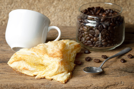 puff pastry: Puff pastry with coffee cup on wooden table