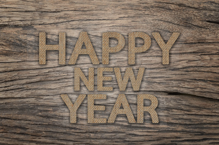sackcloth: Happy New Year, Text design from sackcloth on wood background