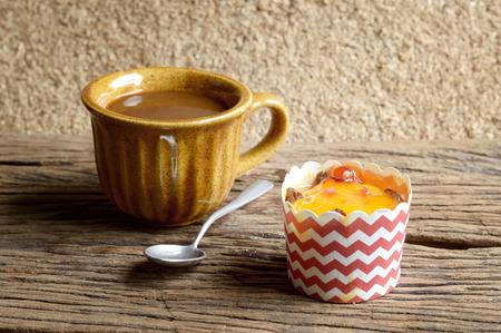 orange cake: orange cake and coffee on wooden table Stock Photo