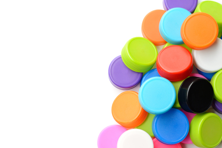 stackable: pile of colorful plastic bottle cap isolated on white background