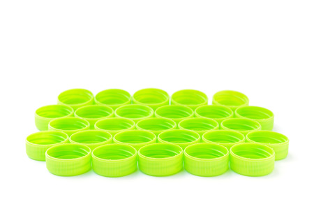 stackable: pile of green plastic bottle cap isolated on white background