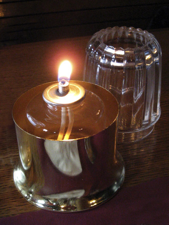 hurricane lamp: Hurricane Oil Lamp burning brightly