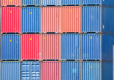 Stacked containers in a shipping terminal Banco de Imagens