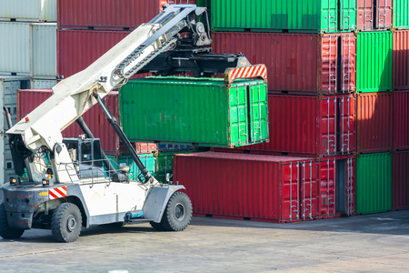 forklift handling the container box in logistic zone
