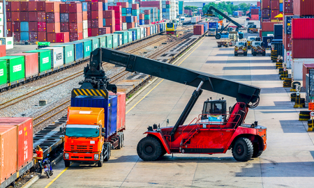 Container Forklift transport by rail.shipping Banco de Imagens