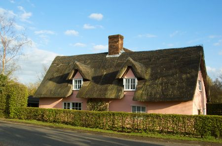 thatched: An english thatched cottage in the countryside