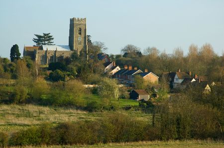 english village: A traditional English village with its church in the evening Stock Photo